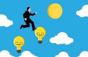 How To Succeed In Online Marketing: businessman stepping on light bulbs to achieve the gold