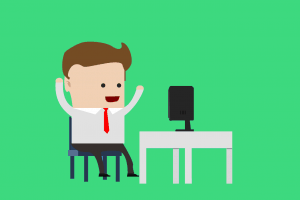 businessman in front of laptop pumping hands in the air