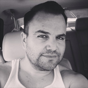 Cesar Ramirez in a tank top