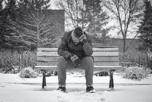 How To Make Digital Products - man on bench in winter