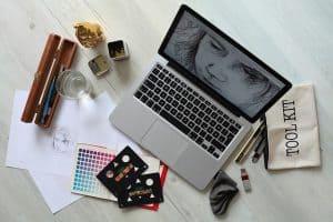 macbook with digital illustration