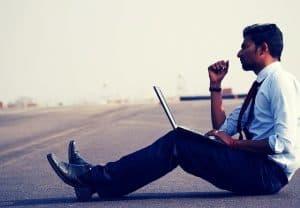 thoughtful man on laptop