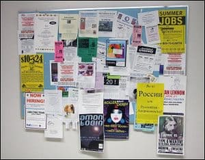 college bulletin board covered by ads