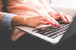 woman typing writing macbook