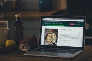 kitchen counter with laptop displaying recipe