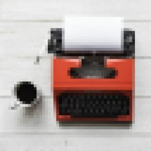 pixelized image of typewriter and cup of coffee