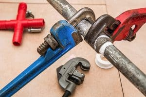 wrenches tightening pipes