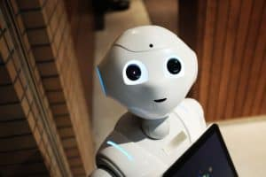robot holding up an iPad