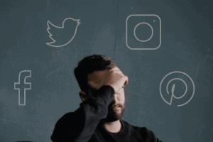 man with headache thinking of social media