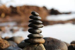 pile of rocks balanced along the beach