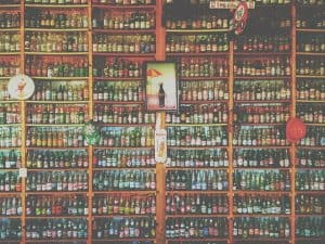 soda bottles on a shelf on a wall