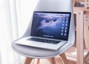 "laptop with ""work anywhere"" as its desktop background"