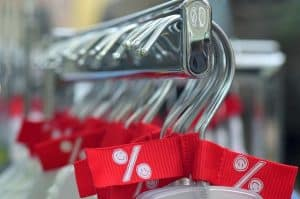clothes hangers with red discount tags