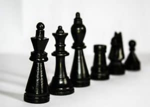 black chess pieces arranged by rank