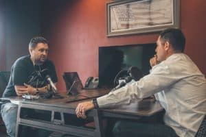man interviewing another man for a podcast