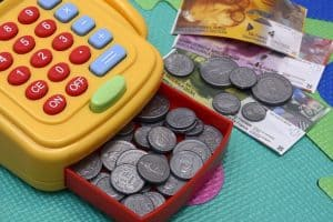 toy cash register with play money