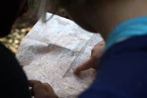 map held by person pointing to a location