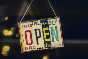"""open"" sign hanging on door of establishment"