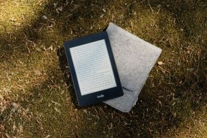 Kindle resting on a leatherette case