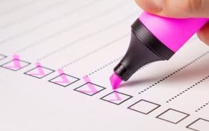 blank checklist being checked by pink highlighter