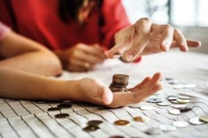 two women counting and stacking coins