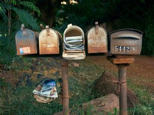old mailboxes with one overflowing