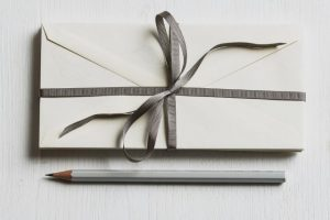 ribbon-bound envelopes plus pencil as a gift set