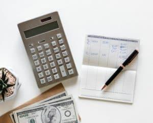 calculator, bankbook, and cash on desk