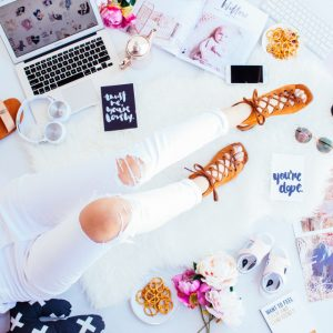 flatlay with laptop and various snacks and a woman's legs