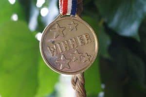 "medal with ""winner"" embossed on it"