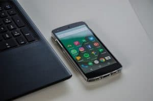 smartphone beside laptop