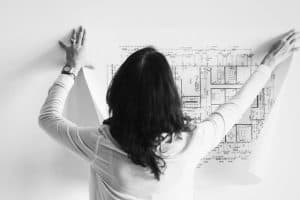 woman putting up a plan