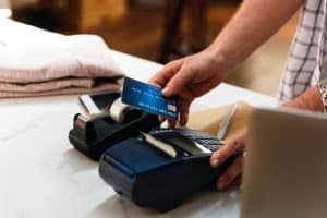 person about to pay with credit card