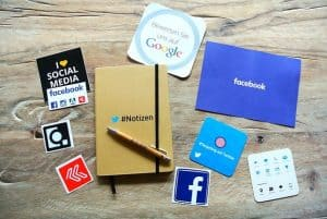 notebook, brochure, stickers with social media logos