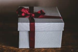 gift box with maroon ribbon