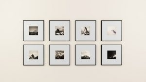 framed photos mounted on a wall