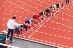 runners on the starting line at a track