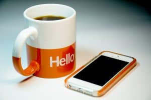 mug of coffee and phone